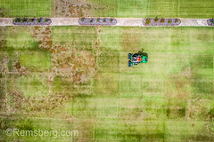 Shot looking directly down at man operating riding lawn mower to cut grass, Tifton, Georgia (Remsberg Photos) Tags: farm georgia bermudagrass research tifton grass turf sod soil lawn outdoors lawnmower mower thesouth americansouth turfcapital agriculture aerial drone mechanical machinery machine grasscutter ridingmower highangle texture usa