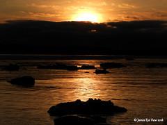 Iceburg Sunrise (JamesEyeViewPhotography) Tags: landscape lake michigan water ice waves winter greatlakes northernmichigan sleepingbeardunesnationallakeshore sky clouds colors nature february lakemichigan jameseyeviewphotography