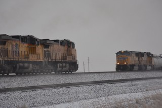 West bound was throttling up and this east bound was creeping down track 4 into Cheyenne.