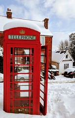 Phone Alone. (Henry Hemming) Tags: phone phonebox red ring home snow england village green snowy white disused rouge bright colourful winter wintry scene old telephone unchanged historic