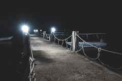 Philippines 4 (aviewthroughalens) Tags: night dock pier walkway lights dark darkness horror mood calm still boats passenger sea water highlights longexposure notripod fujifilm xt2 1855mm classicchrome