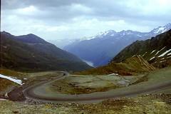 Alpine road (Jurek.P) Tags: alps alpy góry mountains austria road valley lake mountainscape scan minoltadynax7000i jurekp 35mm 2000