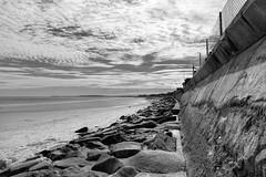 The Wall (WilliamND4) Tags: beach clouds monochrome rocks wall fence nikond810 ocean