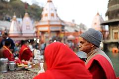 the priest and the pious | Haridwar (arnabchat) Tags: indian uttarakhand haridwar harkipauri ganges ganga river pilgrim ritual priest puja gangaarti aarti temple hindu hinduism evening sunset red dof 6dmkii 35f14lii