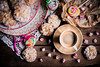 Candy table. (jakub.sulima) Tags: nikon d750 nikkor 50mm 18g wood wooden old vintage italy italian candy sweets biscuit cookies amaretti almond sugar pattern bokeh blur cup coffee espresso lollipop leisure taste kitchen cuisine fun child children inside indoor windowlight studio homemade colours colorful white brown black gold red blue yellow green pink purple orange violet paper lace crema oldfashioned
