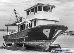 sad boat (smlgndz7) Tags: boat sea bw blackwhite harbor autumn turkey canon kiyikoy clouds sad travel discover nature