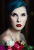 Flowers (Giulia Valente) Tags: portrait portraiture woman beauty beautiful alone cinematic cinema movie story romance romantic one looking light shadow dark beam darkness mood moody atmosphere low key dream inspiring roses flowers red lips blue hair