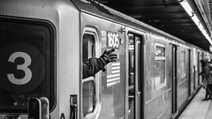 3 (John St John Photography) Tags: streetphotography candidphotography 3train 42ndstreet subwaystation mta grandcentralterminal newyorkcity newyork commuters hand conductor train bw blackandwhite blackwhite blackwhitephotos johnstjohn