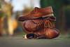 Stacked. Great fun with shoes. (Gudzwi) Tags: tilleulenspiegel schuhe shoes stapel gestapelt stacked stack strase street licht light bokeh sos smileonsaturday 7dwf 7dwfsaturdayslandscapes landscape sonnenlicht sunlight leder leather braun brown metoo