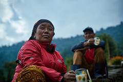 Gurung woman and man drinking tea, Chomrong, Annapurna massif, Nepal (Alex_Saurel) Tags: group asia culture portray tradition photoreport plantaille asian posing day annapurnabasecamptrek reportage travel 35mmprint portraiture people traditional nepal photospecs portrait abctrek imagetype asie nature photojournalism lifestyles scans pose halfbody stockcategories time annapurnaconservationarea photoreportage sony50mmf14sal50f14