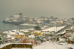 Welsh village in the snow. (alex.vangroningen) Tags: village snow houses roads castle colors sea wall steep jetty hills wales gb viewpoint