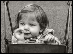 Grand Daughter #18 2018; Bye-Bye (hamsiksa) Tags: child children childrenplaying playgrounds swings girl baby infant toddler littlegirl swinging playing waving wavingbyebye byebye generations daughter granddaughter portraits portraitsofchildren informalportraits candidportraits blackwhite blackwhiteportraits