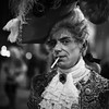 Dandy in the Underworld 122/156 (markfly1) Tags: italy venice carnivale dandy costune man smoking cigarette street candid portrait light dark bright shadow fantastic costume jewellery amazing hat brilliant outfit night photography nikon d750 50mm lens shallow focus wide open wonderful wig flickrcarnival