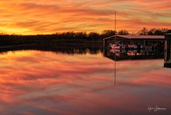 2 Legged Thing (Rajesh Jyothiswaran) Tags: boats clouds collin county colorful fiery lake lavon marina reflection sunset texas vintage water dallas