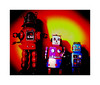 Welcome to our world ! (CJS*64) Tags: robots toys tintoys lx100 panasoniclx100 panasonic cjs64 craigsunter cjs psychedelic highcontrast tabletop colour colours three row