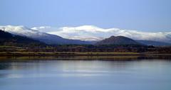 Sutherland hills (stuartcroy) Tags: scotland hill mountain snow scenery sony sea still reflection
