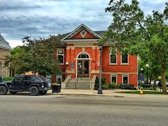 Elora - Ontario - Canada -   The Elora Branch of the Wellington County Library System - Heritage Building (Onasill ~ Bill Badzo) Tags: wellingtoncounty elora on ont ontario mian street branch heritage library carnegie building red public onasill walking tour iphone phonegraphy salem architecture beaux arts style historic southern canada town village jeep nopeople hummer