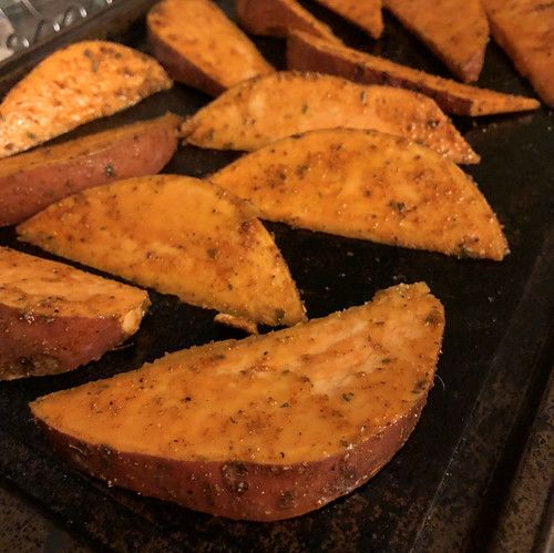 I made some tasty sweet potato wedges with paprika, pepper, cumin and garlic to go with our steaks tonight.