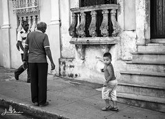 Boy Going Somewhere (Wits End Photography) Tags: boy decay monochrome street people photojournalism cienfuegos walking cuba children places streetphotography bw black blackwhite blackandwhite drive gray grey pavement road roadway route white