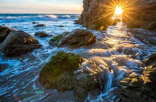 Malibu California Sea Cave Starburst Sunset! Red, Yellow, Orange Clouds! Magical El Matador Beach Sunset! Nikon D810 HDR Photos Dr. Elliot McGucken Fine Art Landscape Photography!  14-24mm Nikkor Wide Angle F/2.8 Lens