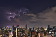 Weather the storm (Sumarie Slabber) Tags: storm lightning city night lights manila makaticity phililippines buildings clouds weather stormy sky sumarieslabber ayalaave nikon cityscape nightscape aerial