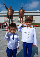 North Korean children saluting like soldiers in front of the statues of the Dear Leaders in Mansudae Grand monument, Pyongan Province, Pyongyang, North Korea (Eric Lafforgue) Tags: architecture asia boy boys boysonly childhood childrenonly colourimage communism cultofpersonality dailylife day dictator dictatorship dprk ideology img7114 kepi kimilsung kimjongil mansuhill mansudaehill memorial monument nationallandmark northkorea northkorean outdoors patriotism people propaganda pyongyang statue traveldestinations twopeople vertical youth pyonganprovince 北朝鮮 북한 朝鮮民主主義人民共和国 조선 coreadelnorte coréedunord coréiadonorte coreiadonorte 조선민주주의인민공화국 เกาหลีเหนือ קוריאההצפונית koreapółnocna koreautara kuzeykore nordkorea північнакорея севернакореја севернакорея severníkorea βόρειακορέα