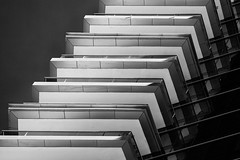 Balconies (laga2001) Tags: building architecture repeating repetition modern contemporary contrast light blackandwhite bnw bwphoto urban monochrome diagonal lines geometry