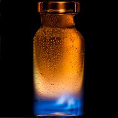 Bottled Flame (Mark Wasteney) Tags: macromondays2nds bottle flame macro blue orange squareformat