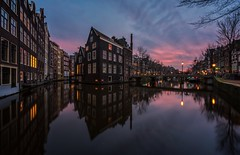 Amsterdam canals (reinaroundtheglobe) Tags: amsterdam amsterdamcanals nederland thenetherlands netherlands dutchlandscape dutch canal canalhouses sunset skycolorful wideangle panorama longexposure bluehour architecture