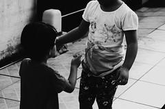 Friend. (Karoline Bastos) Tags: nikon nikonphotography nikonworld brazilianchild blackandwhite bw children child childphotography close amazing sweet sweetthings d7000 kid kidphotography kids light littlegirl little boyandgirl toddler
