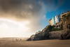 Winter At Tenby (Chris J Richards Photography) Tags: landscape beach cliffs clouds coast cymru pembrokeshire people sand seaside seasons silhouettes stone sunlight tenby wales walkers walls wind winter