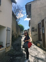 Girl with red bag (bethany-j-hirst) Tags: stripy redbag red smile happy happytunes adventure travelling travel memories sunshine sunny sun photographs photography castle sunglasses cute summer skirt shirt bag girl french france carcassonne