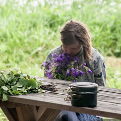 Young girl sniffing flowers sitting at the table (Denis Vahrushev) Tags: russia southernural ural aquamarine attractive beautiful bellflower besom birch blue bright broom brown calm campanula cold day dishes dress female filllight flower furniture girl glow grass green grey hair hike journey july landscape light loneliness lowcontrast meditation melancholy model morning nature outdoor pan pants park people person plant portrait pretty purple season serenity solitude summer sunlight tshirt table travel tree trip trousers turquoise violet woman young nizhniyufaley chelyabinskayaoblast ru