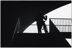 girl in black & white (stevefge (away travelling)) Tags: bridge gelderland nijmegen oversteek bridges people candid street girls bicycles bikes fiets silhouette blackandwhite bw zw zwartwit monochrome contrast stairs steps arch railings nederland netherlands nl nederlandvandaag reflectyourworld minimal