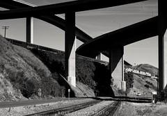 Benicia bridges (rolfstumpf) Tags: usa california benicia interstate bridge amtrak passengertrain telegraph monochrome blackwhite blackandwhite contrast railway railroad unionpacific olympus