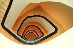 Finale shot (Elbmaedchen) Tags: staircase stairwell stairs stufen steps spirale spirals treppenhaus treppenauge escaliers escaleras wendeltreppe roundandround downstairs orange architektur architecture interior future space