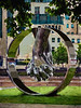 The Wedding Ring (Steve Taylor (Photography)) Tags: wedding ring holdinghands art digital sculpture silver metal uk gb england greatbritain unitedkingdom london trees grass leaves reflection lorenzoquinn love aluminium millbank riversidewalkgardens vauxhallbridge