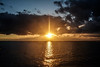 Il saluto del sole - The greeting of the sun. (sinetempore) Tags: mare sea ionio salento puglia portocesareo tramonto sunset sole sun luce light nuvole clouds paesaggio landscape barca boat barchetta ilsalutodelsole thegreetingofthesun