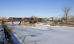 Backing up over the Lachine Canal (Michael Berry Railfan) Tags: cn canadiannational montreal montrealsub lachine sthenri quebecgatineaurailway train freighttrain cn527 sd60 gp402lw emd gmd dash9 dash944cw ge generalelectric