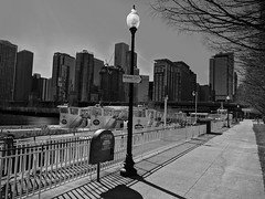 Waiting (ancientlives) Tags: chicago chicagoriver illinois il usa taxi watertaxi boats riverboat walking city streetphotography cityscape skyline towers buildings skyscrapers lake lakemichigan lakefronttrail lakeshore navypier mono monochrome blackandwhite bw sunday 2018 march winter ngc