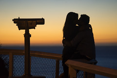 Couple kissing at Oliver's Hill Lookout (Kokkai Ng) Tags: frankston couple kissing melbourne sunset lookout olivers hill melbourneaustralia australia victoriaaustralia horizontal photography romance dating loveemotion scenicsnature observationpoint lookouttower orangecolor dusk silhouette opticalinstrument binoculars telescope famousplace twopeople couplerelationship youngcouple romanticactivity romanticsky highup heterosexualcouple men women datenightromance passion outdoors clearsky incidentalpeople australianculture people peeking looking tourist tourism travel watching 2029years youngadult olivershilllookout voyeur