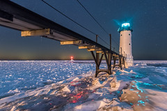 Manistee Harbor Lights (Aaron Springer) Tags: michigan northernmichigan lakemichigan thegreatlakes manisteenorthpierheadlight manisteeriver pier catwalk winter snow ice nightsky stars lighthouse harbor nightphotography outdoor landscape