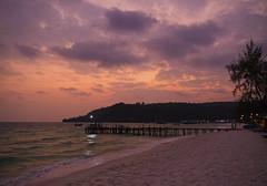 Sok San sunset (ORIONSM) Tags: soksan kohrong cambodia asia sunset island clouds pastel pink sky beach sand shore jetty dusk silhouette trees palm golden hour olympus omdem1 olympus14150mm