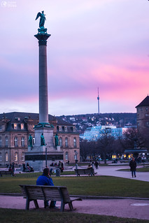 Man Sitting Alone on Bench Watching Stuttgart Schlossplatz Sunset