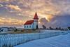 Akureyjarkirkja Church (1912) (Clint Everett) Tags: landscape iceland church rural country akureyjarkirkja grindavík sunrise clouds sky winter snow picketfence cemetery