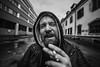 Portrait de rue (theodirector) Tags: monochrome blackandwhite noiretblanc symetry streetphoto streetphotography symetric french frenchman beard beardman bearded smoke smoking smoker cigarette cigarettebreak street streetlife streets streetphotographer streetreport grimace funnyface cowboy raining rain cold wideangle 14mm wideanglelens angry building buildings industrial besancon besançon streetportrait portrait portraitphotography zone industrialzone abandoned