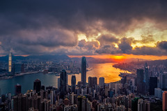 Hong Kong City skyline at sunrise. Hongkong skyscraper view from The peak (MongkolChuewong) Tags: aerial architecture asia asian background beautiful blue building buildings business china city cityscape day district downtown evening harbor harbour hong hongkong kong landmark landscape light metropolis modern mountain night office panorama panoramic peak peaks reflection scene scenic sea sky skyline skyscraper sunrise sunset tourism travel traveler urban victoria view