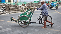 Cyclo Pusher (CAMBODIA) (ID Hearn Mackinnon) Tags: cyclo man pushing cambodia cambodian south east asia asian 2017 green wheel phnom penh people culture transport bicycle taxi river side riverside road