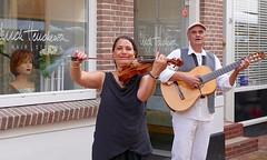 A personal note (andzwe) Tags: meppel dmd straatmuzikant streetmusician violin violist guitar gitarist streetperformers woldstraat kapper kapsalon panasoniclumixdmcgh4 flamenco flamencoduo donderdagmeppeldag straatmusici smile viool acousticguitar akoestischgitaar