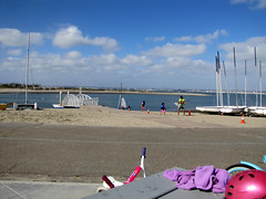 IMG_7047 (classroomcamera) Tags: blue ocean water sky clouds boat sailboat pink helmet road beach sand purple tan yellow relax